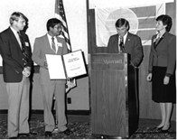 Subrato Chandra receives the Governor's Energy Award from Governor Bob Graham.