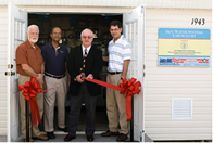 Department of Energy's Bob Hasset celebrates opening of Hot Water Systems